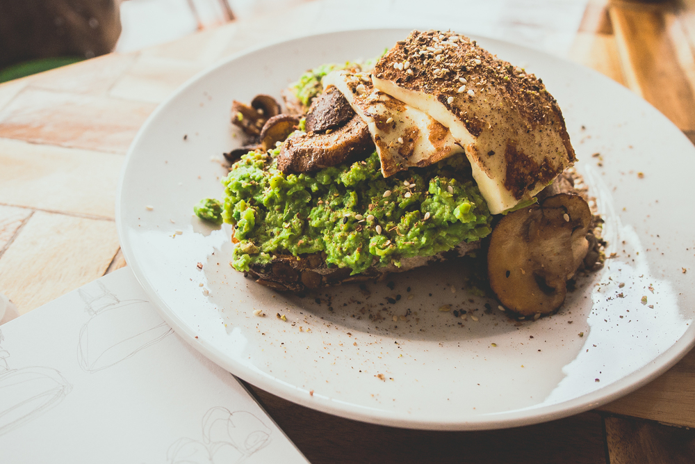 Mashed peas & grilled mushrooms: with dukkah seasoning, served on toasted pumpkin bread with grilled haloumi - $13.00