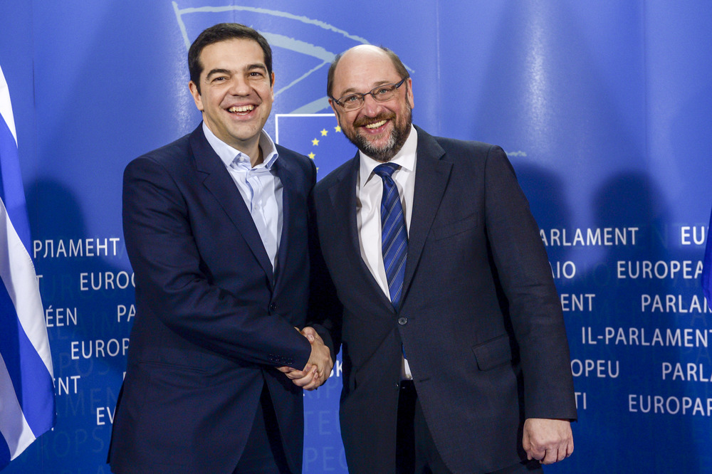 Greek Prime Minister Alexis Tsipras, left, shakes hands with European Parliament President Martin Schulz during a 4 February meeting in Brussels.(via  Flickr )