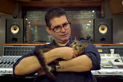 Nothing says hardcore punk rocker like snuggling with his kitty. If the cat had a punk rock name like Puke, it might work, but the cat's name is Lil Bub.