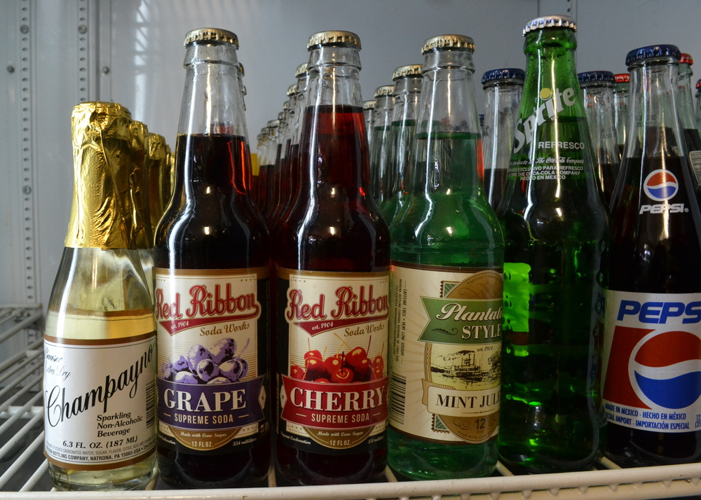 Our inventory includes many local products including glass bottled soda.