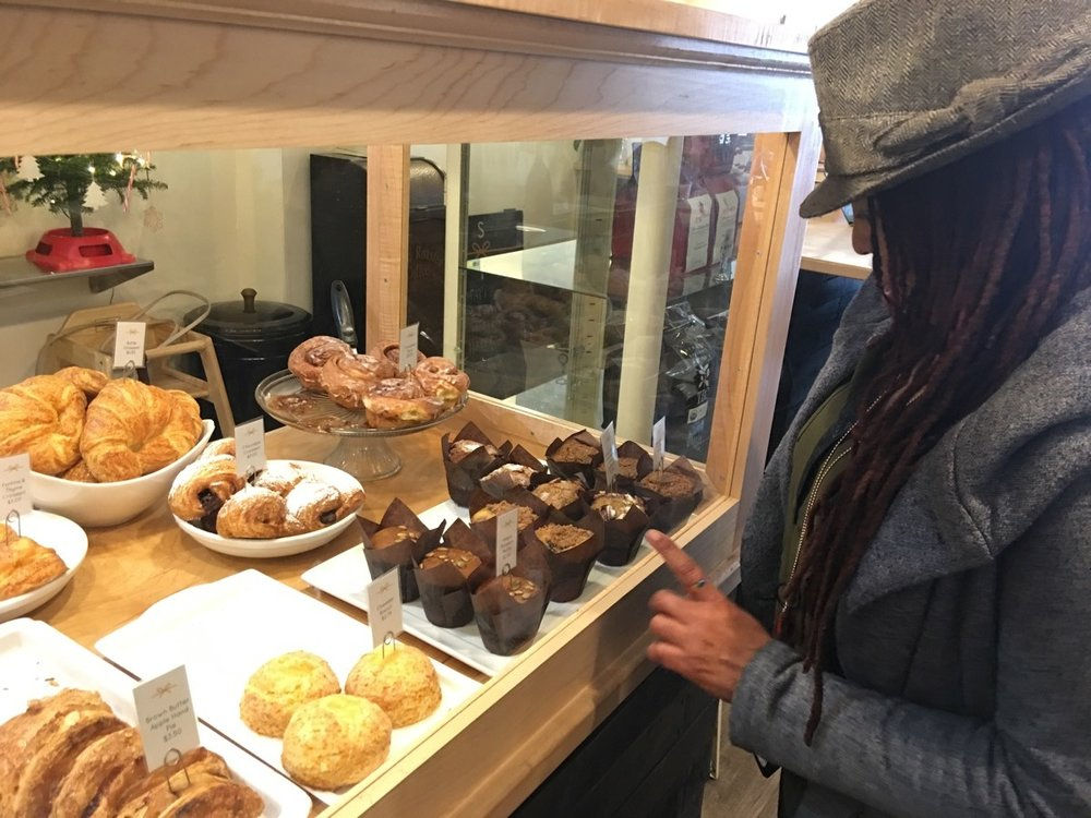 A look into the pastry case at Sugar and Twine. Ayana is eyeing those vegan muffins.