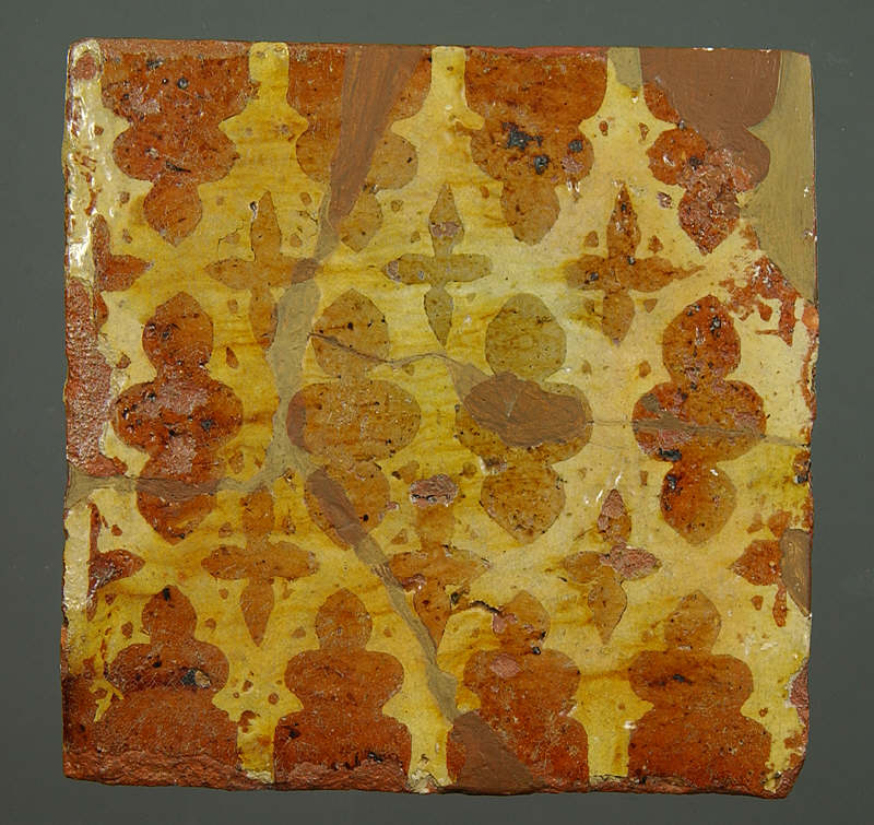 Inlay tile depicting quatrefoil tracery from Neath Abbey, mid 14C. ©National Museums & Galleries of Wales