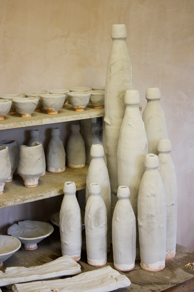 Finished glazed pots ready to be fired