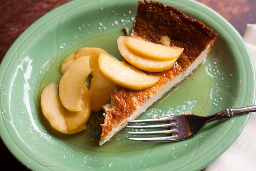 Ricotta and Caprino cheese cake with slice peaches in honey