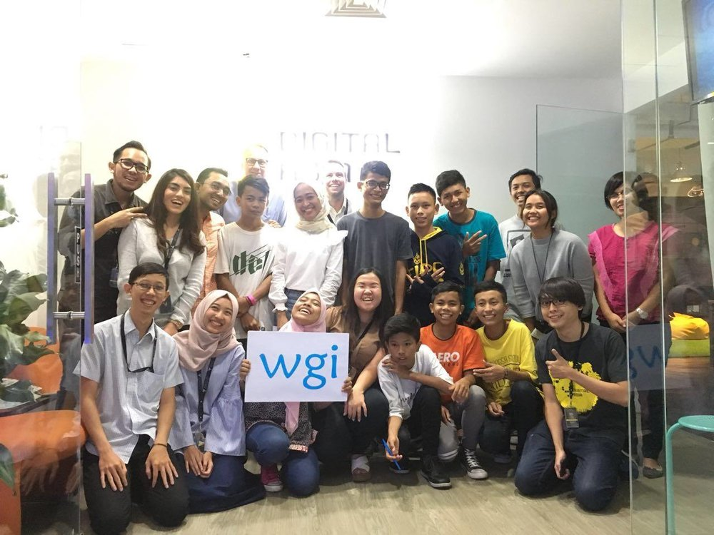 Volunteers and students pose for the first Read & Rice session in Jakarta.