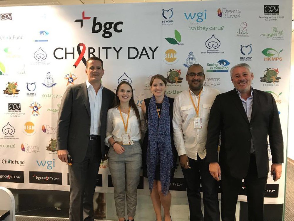 Representatives of WGI pose with BGC Partners Executive Mark Webster
