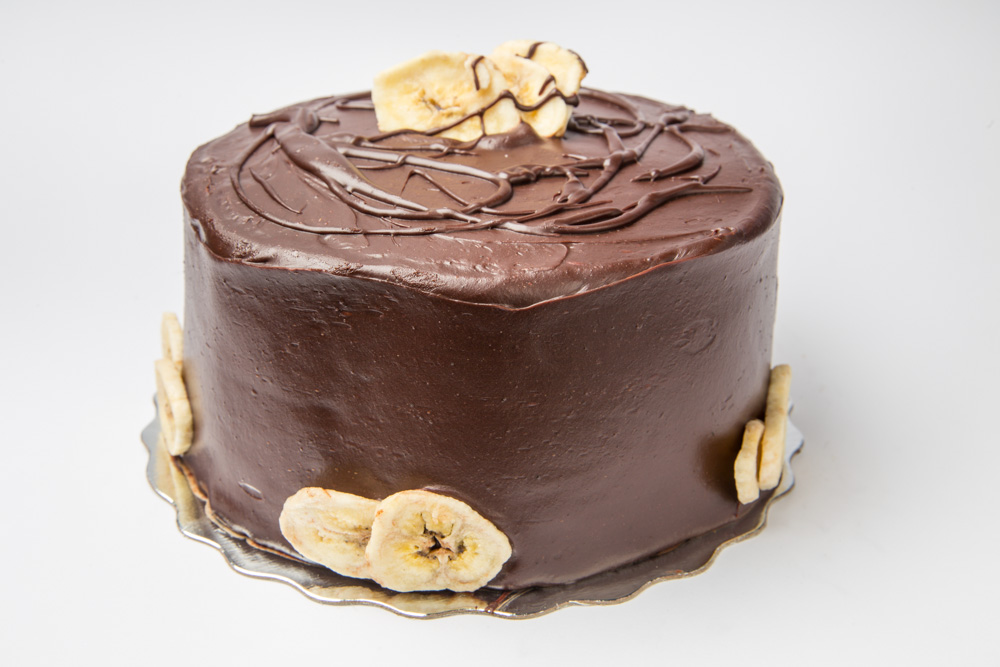 Chocolate Banana   Dense banana cake and our fabulous chocolate cake layered and iced in chocolate fudge frosting.