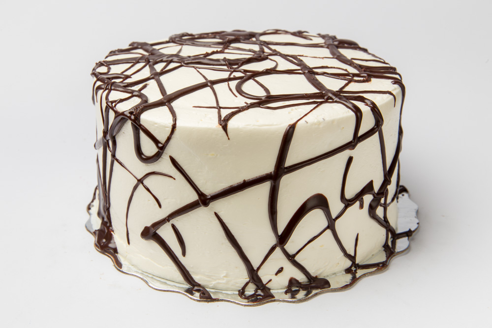 Dad's Chocolate   Dark, dense chocolate cake iced in our creamy vanilla buttercream frosting.