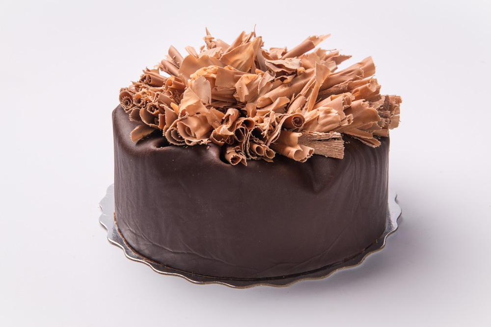 Flourless Chocolate Rich, dense and decadent, our flourless chocolate cake is topped with chocolate mousse and rolled chocolate.
