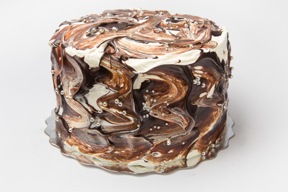 Marble Galaxy   Layers of chocolate and vanilla intermingled with vanilla buttercream and chocolate fudge frosting.