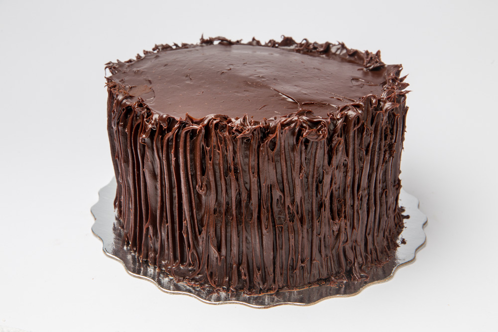 Mom's Chocolate Layer Cake   Simply the best chocolate layer cake ever. Rich, dense chocolate cake iced in a fudge frosting.