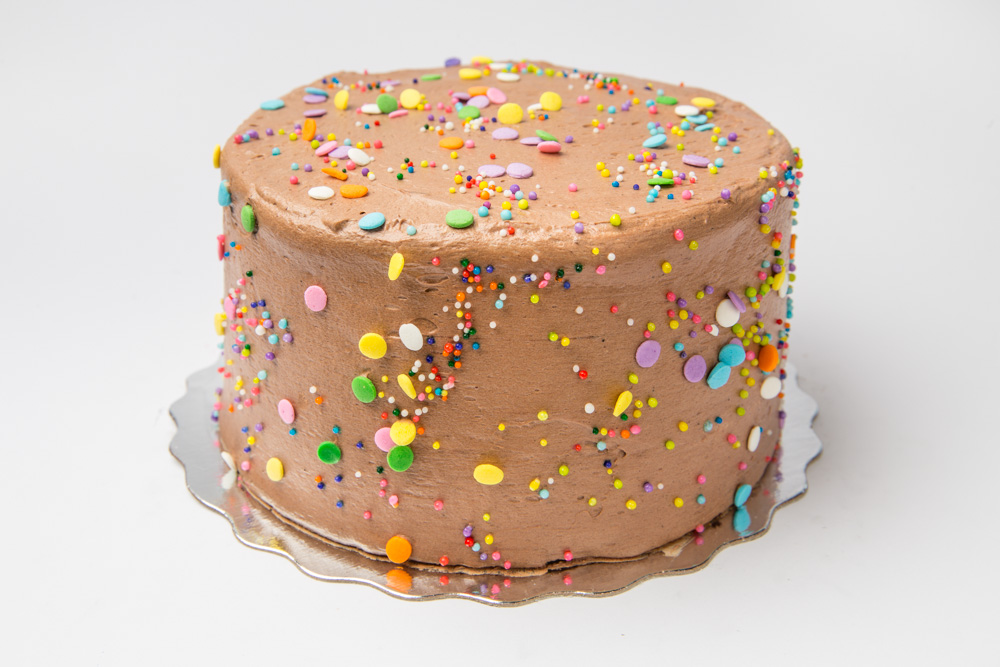 Really Vanilly 2.0 Our vanilla cake iced in a milk chocolate icing topped with colourful confetti.