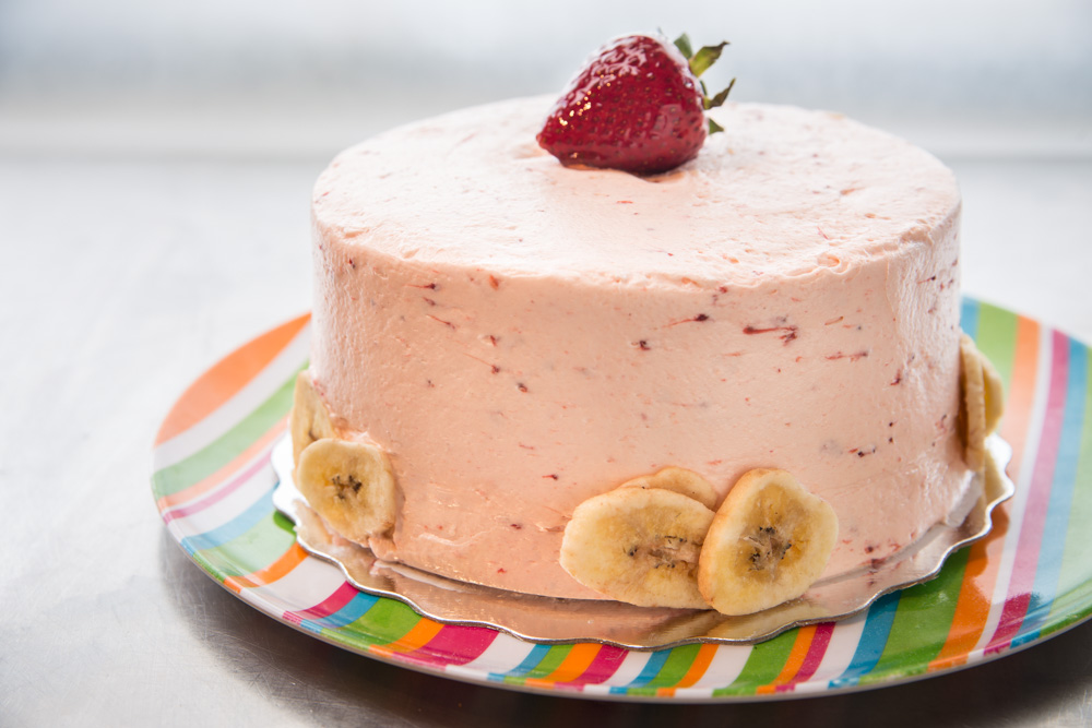 Strawberry Banana Smoothie Works for a smoothie so why not for a cake! Banana cake with a chunky strawberry frosting.