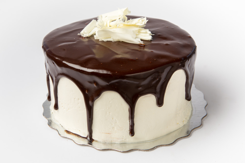 Vanilla Fudge   Our luscious vanilla cake layered with fudge frosting, finished with buttercream and topped with chocolate frosting.