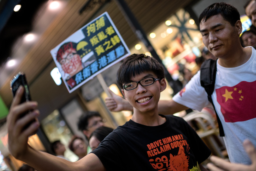 Joshua Wong and pro-China protester