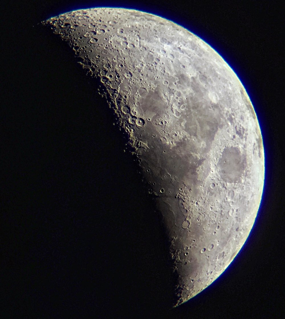 Moon through telescope lens