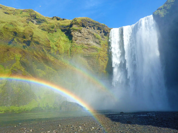 Skogafoss waterfall in Iceland with a double rainbow