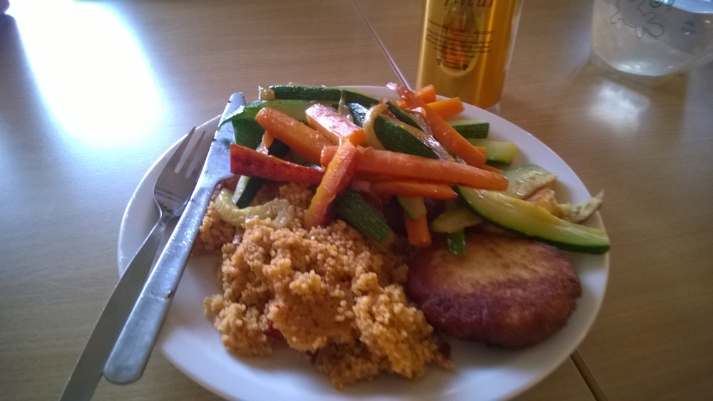 Fish cakes, couscous, and sauteed zucchini and carrots