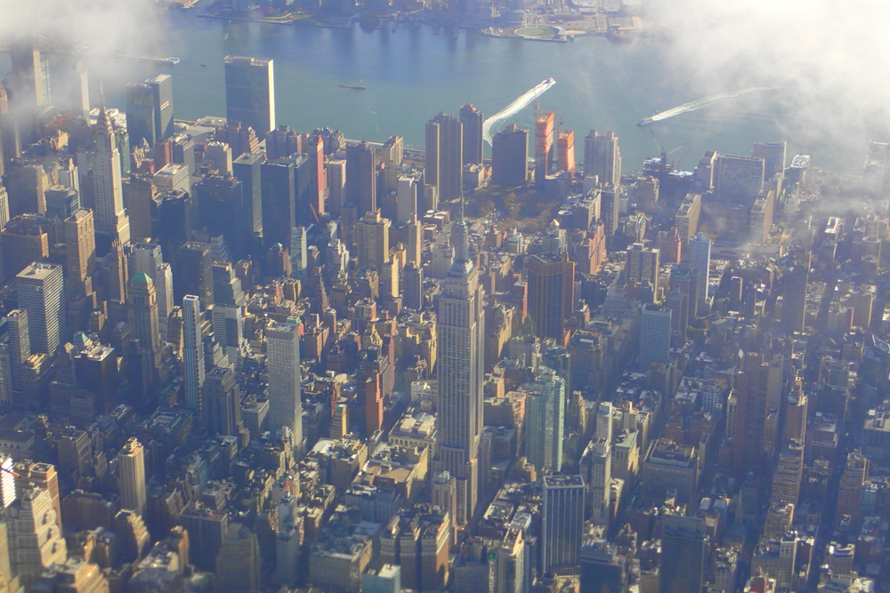 The Empire State Building (tallest building at center) and Chrysler Building (Upper Left)