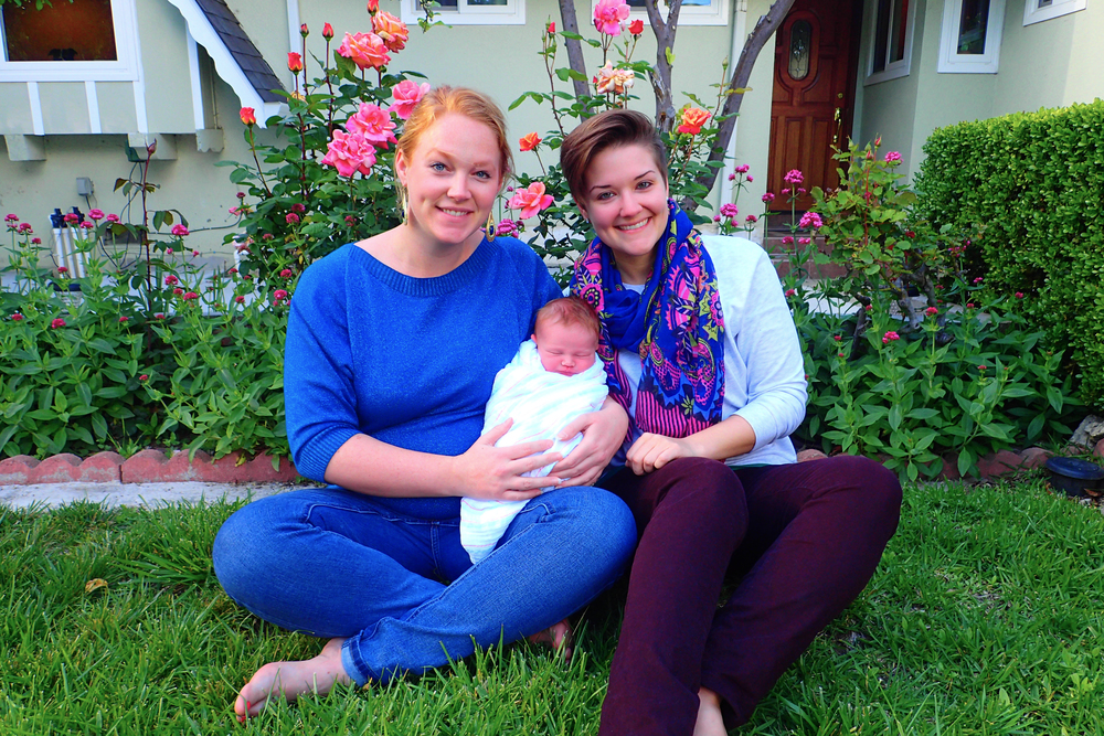 Erin, me, and baby Logan in front of their home in California