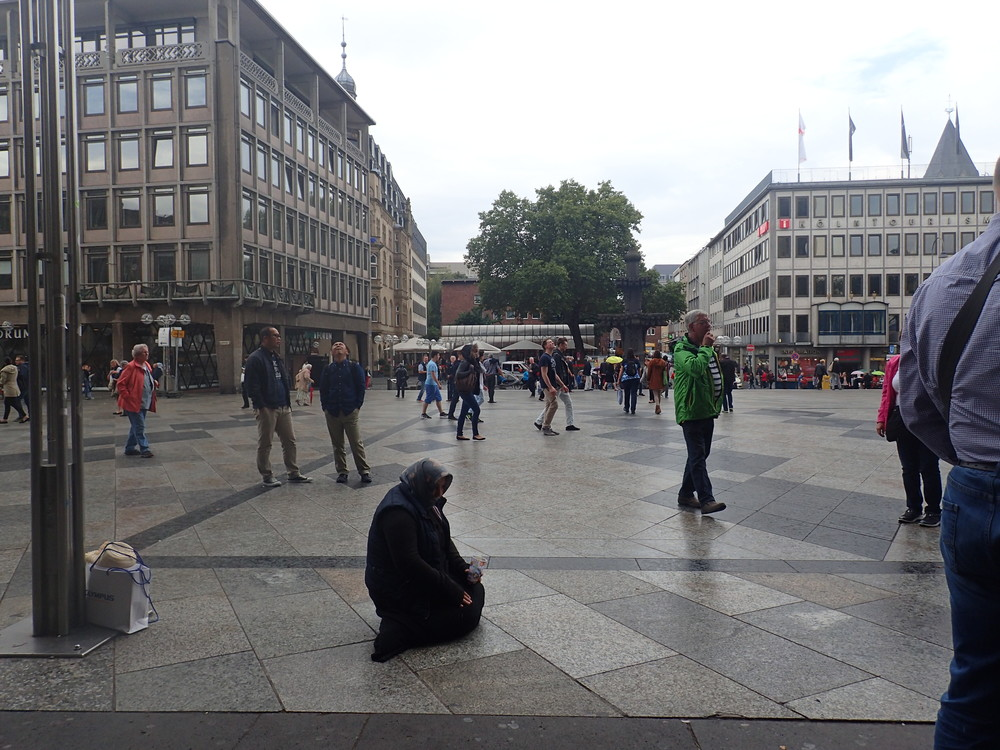 A woman begging outside The Cathedral in  Cologne, Germany