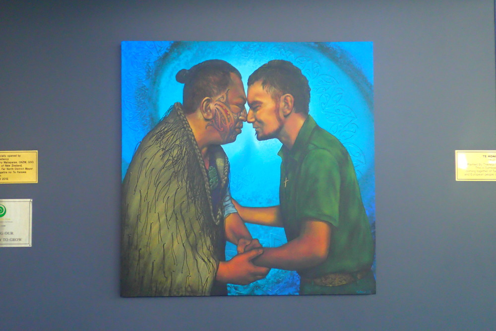 "At the Far North iSite in New Zealand, this painting hangs representing the traditional Māori ""hongi"" — a greeting of pressing of the noses and foreheads together"
