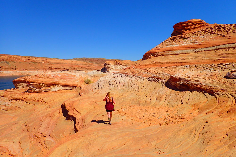 "Erin making her way down the rocks to ""The Chains"" on Lake Powell"