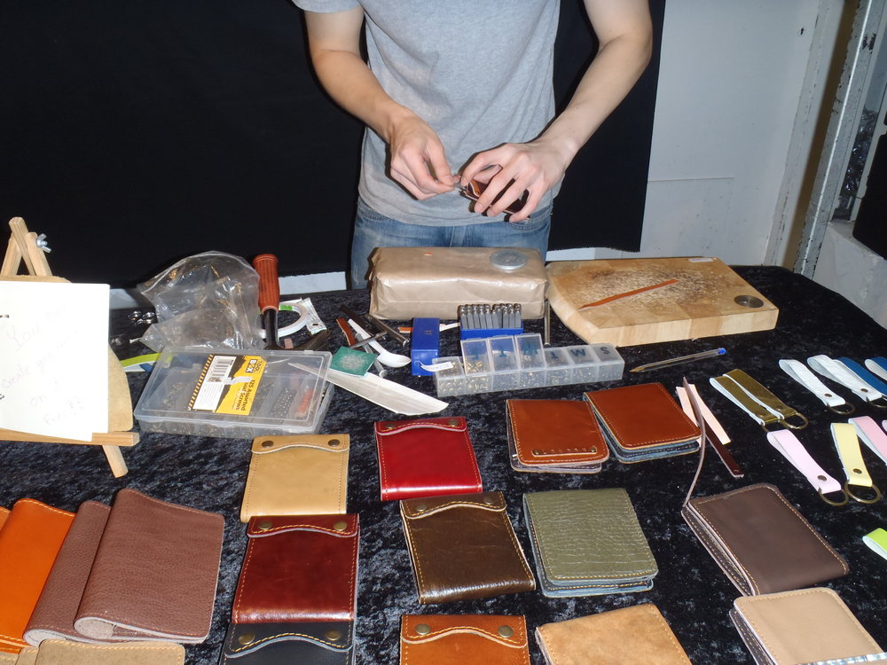 Getting my wallet custom made at the Brick Lane Markets in London back in 2012