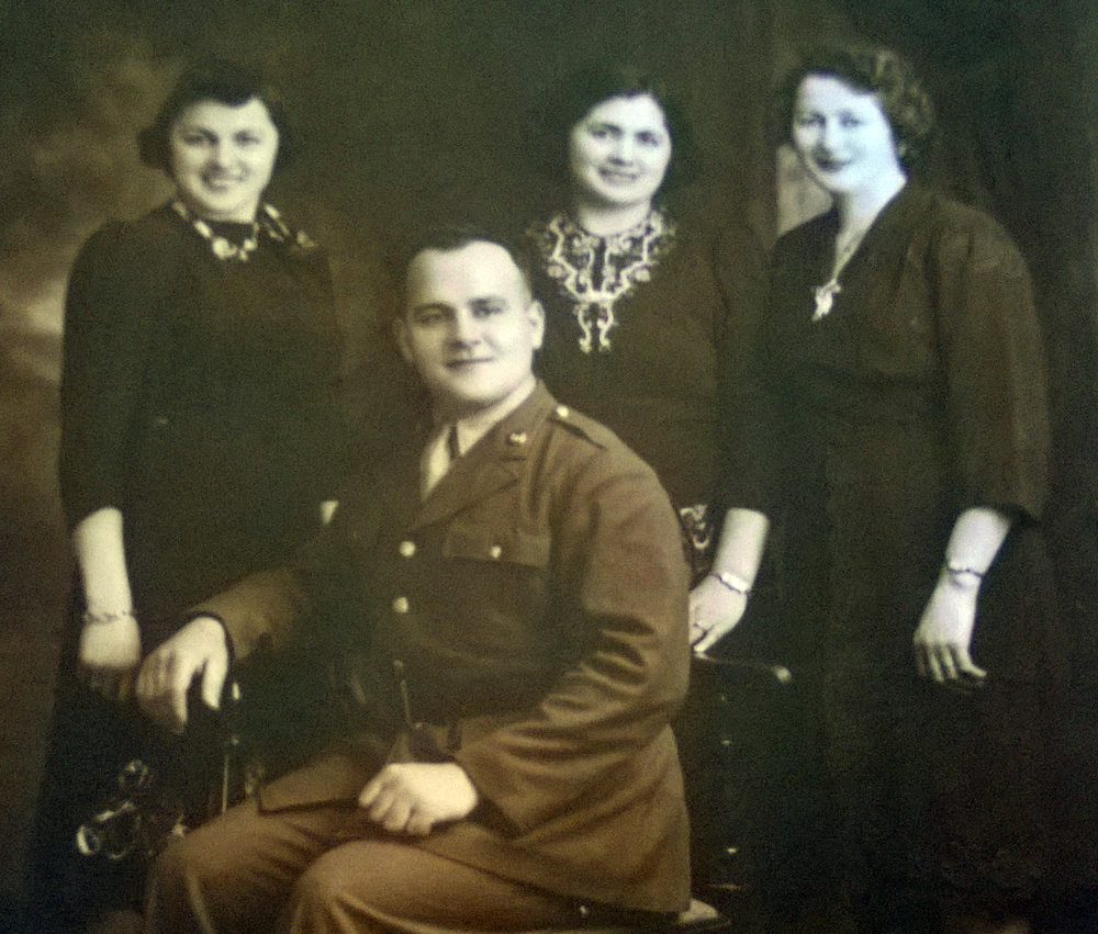 Wally (left) with most of her siblings including my grandfather