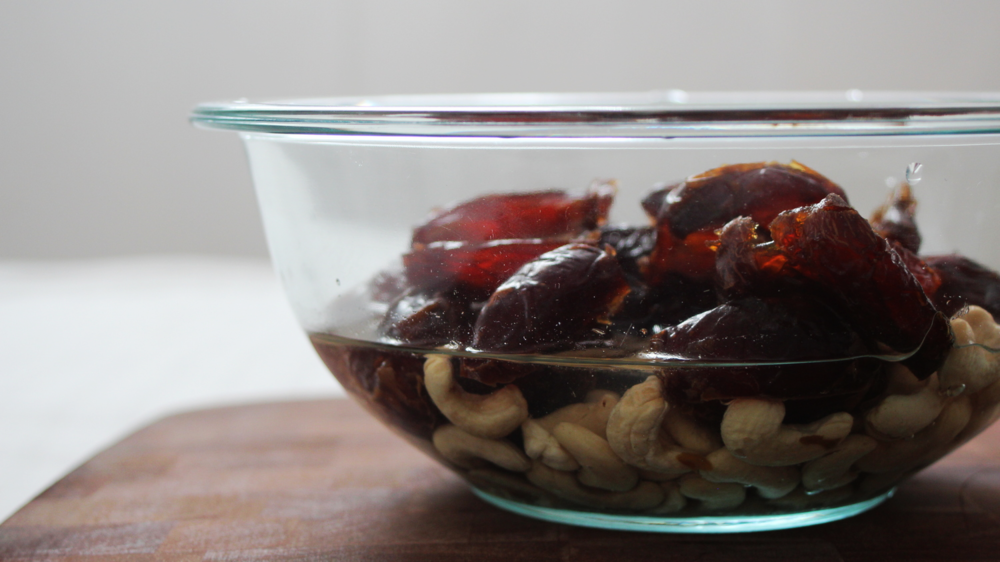 Step 3: While dates and nuts are soaking, line loaf pan with plastic wrap and brush lightly with oil.