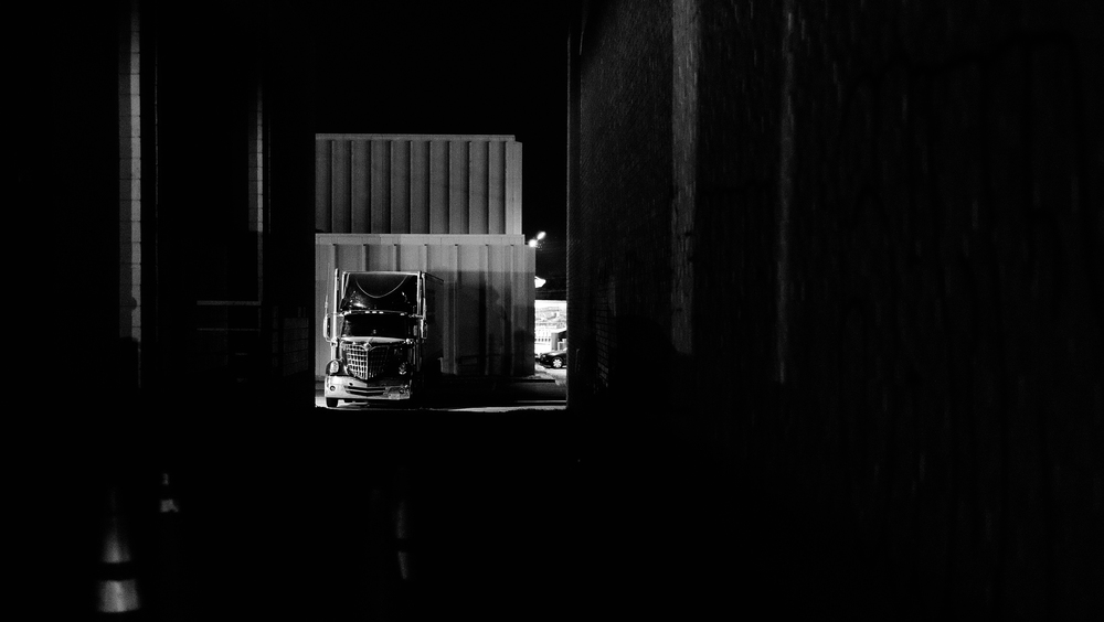 parked_truck_night_alley.jpg