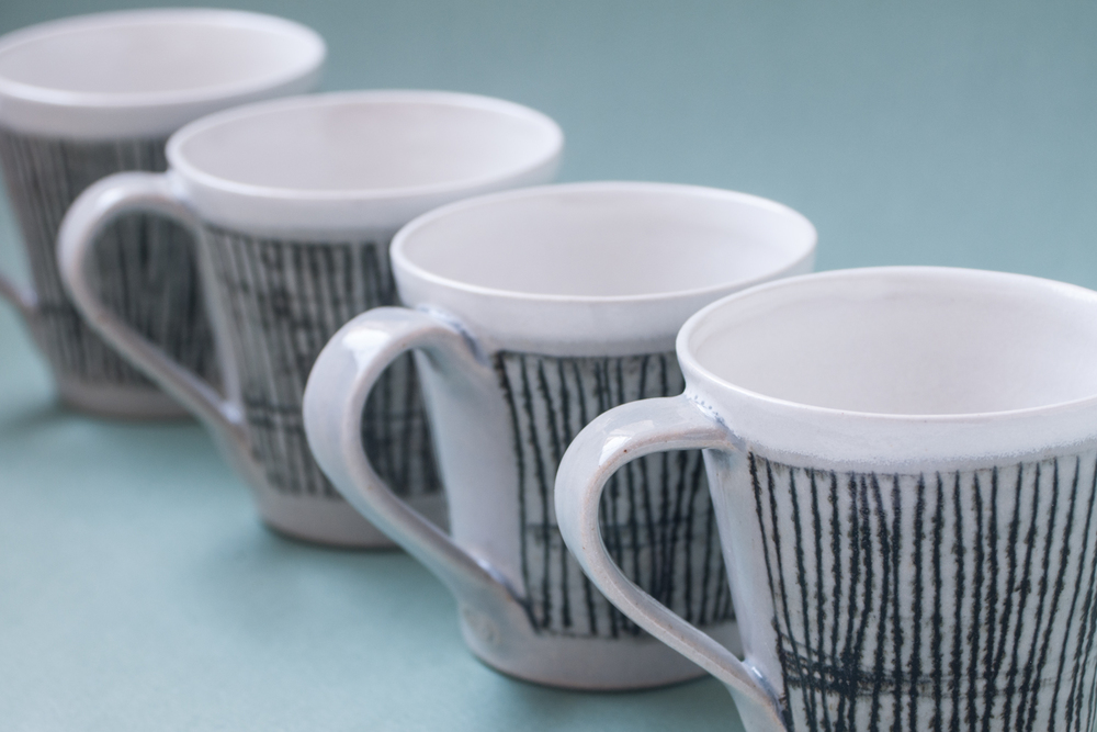 Topsy Jewell black and white striped ceramic cups