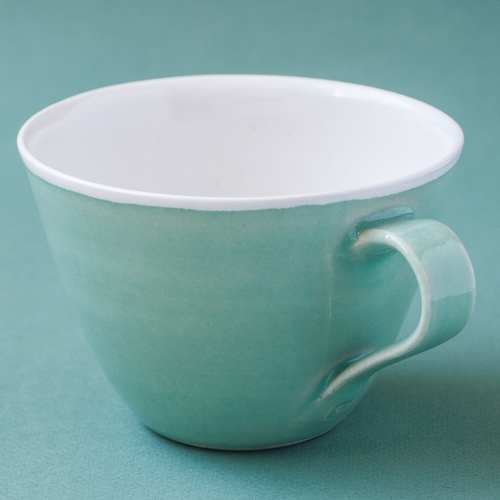 Topsy Jewell green pottery cup