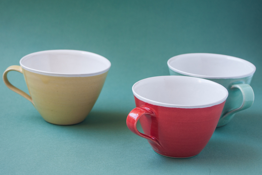 Topsy Jewell's red, yellow and green ceramic cups