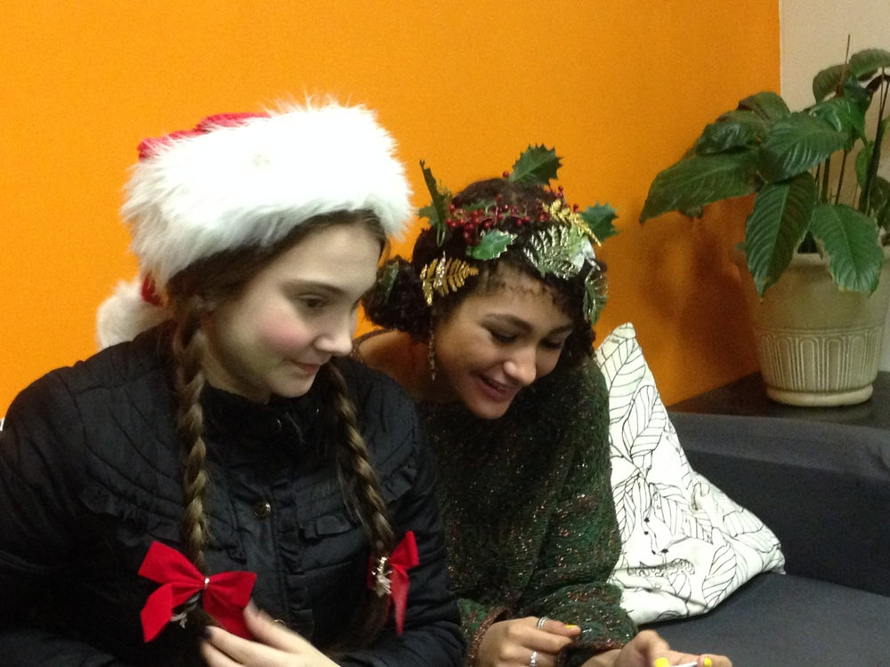 """High school students dress as """"Santa's Elves"""" and escort our young visitors for pictures with Santa."""