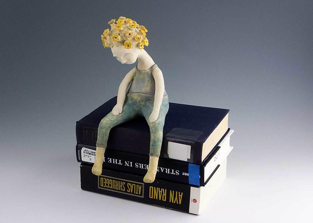 Doll-on-Books.jpg