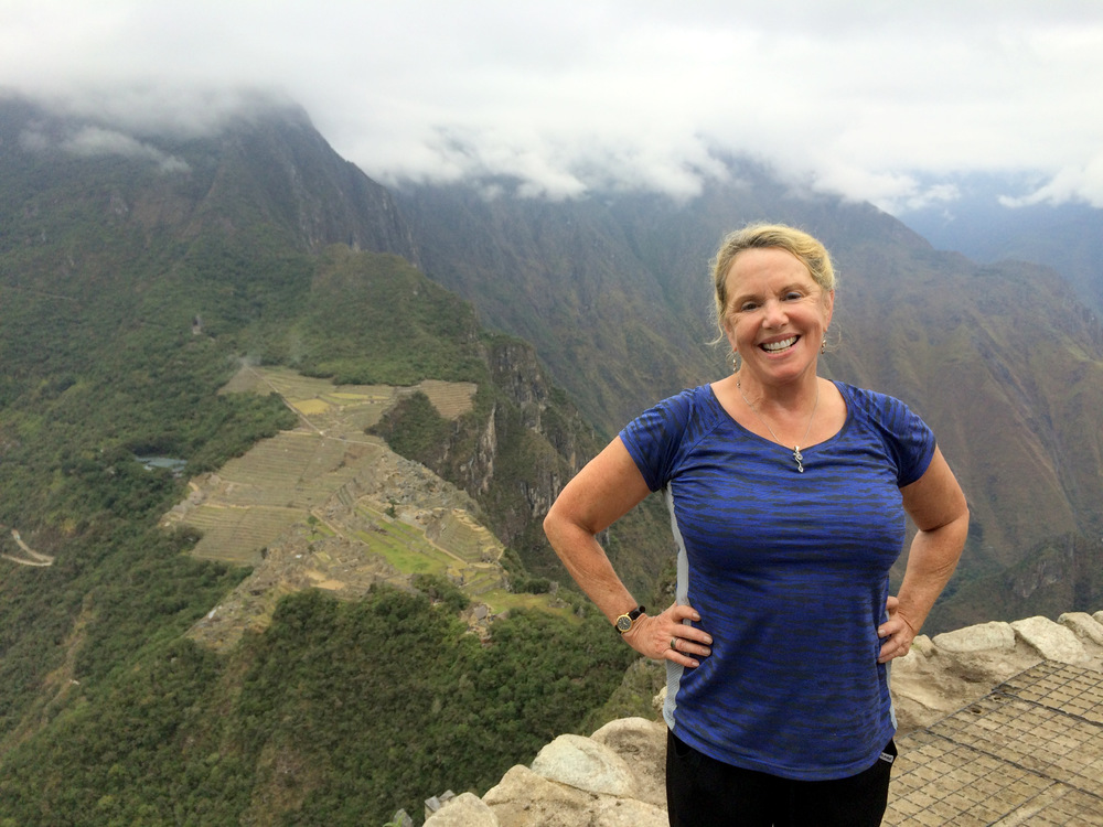 Client, Kathy K., standing proud after a hike on her REI active tour of the Galapagos and Machu Picchu.