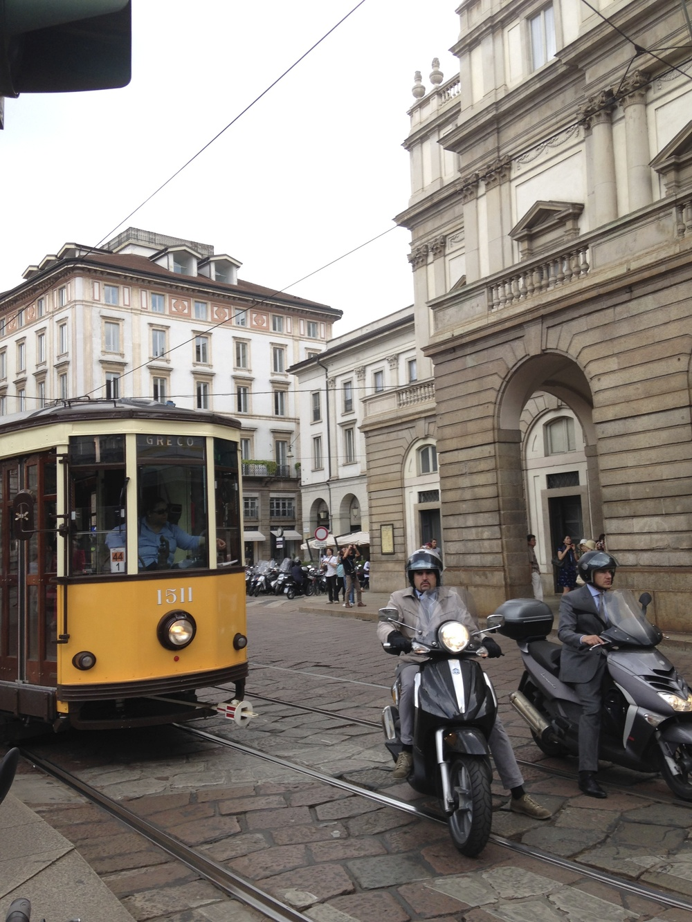 Too perfectly Italian for words! Suits on vespas and an old tram in front of the Scala.