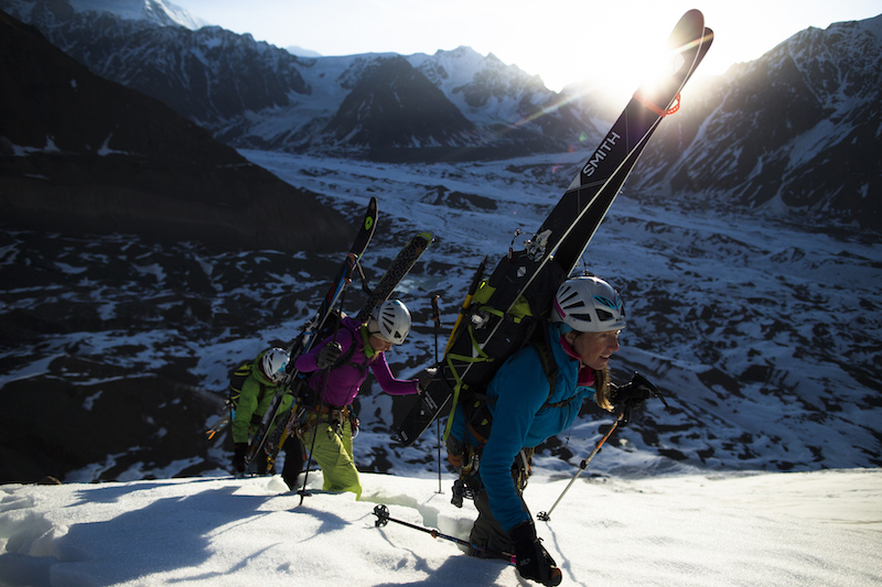 Jessica Baker leads Emillie Drinkwater and Sheldon Kerr up a ridge line overlooking the Barnard Glacier in the Wrangell St Elias Mountains in AK.  (C) Krystal Wright
