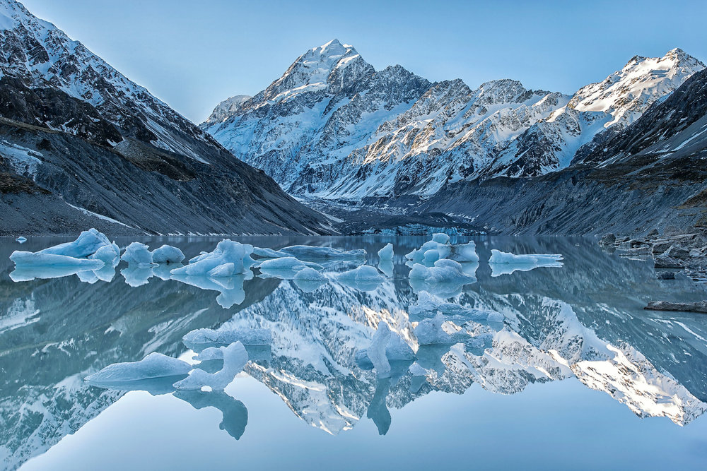 Reflections at Hooker Lake, Mount Cook, NZ – Mount Cook is one of my favourite NZ locations, you can see why! It was perfectly still this evening so the icebergs (rare in inland lakes) reflect beautifully in the lake.