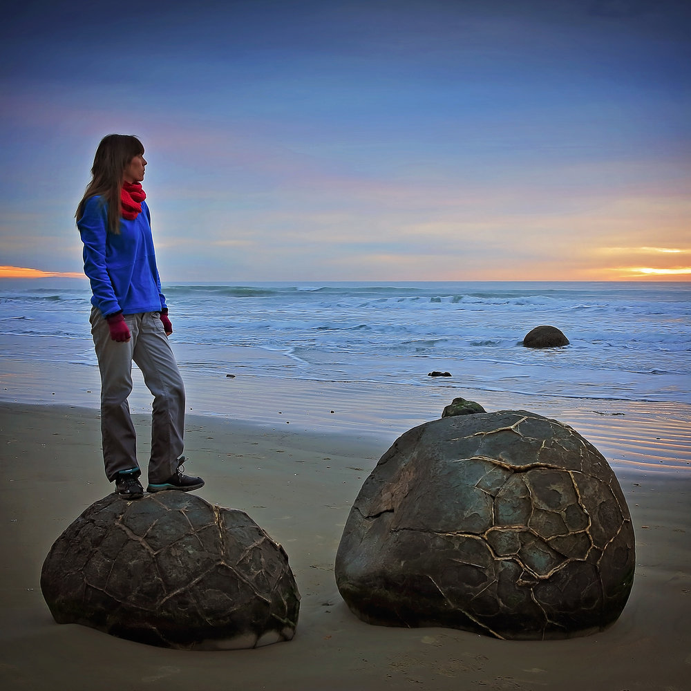 Self Portrait at the Moeraki Boulders, NZ – These boulders are astounding! Perfectly round and laced with quartz, they appear to have rolled out of the cliff and onto the beach. This was taken after a spectacular sunrise on a recent rip to NZ.