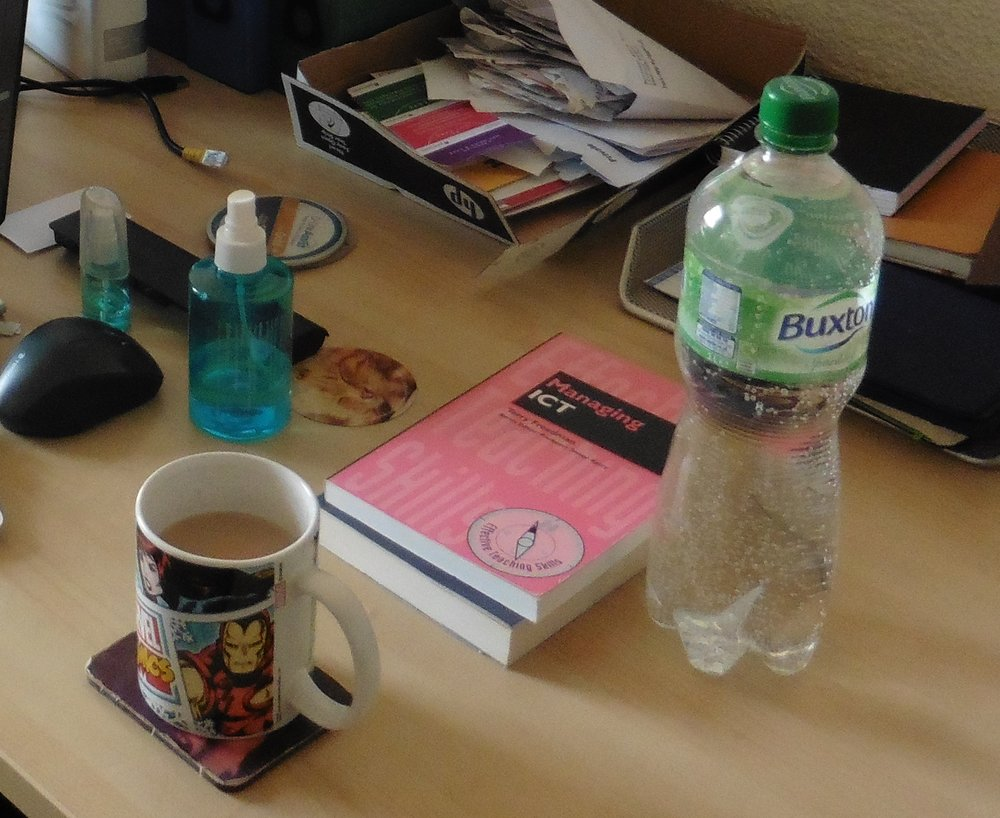 The bare essentials: coffee, water, notebook, computer -- and a good book!