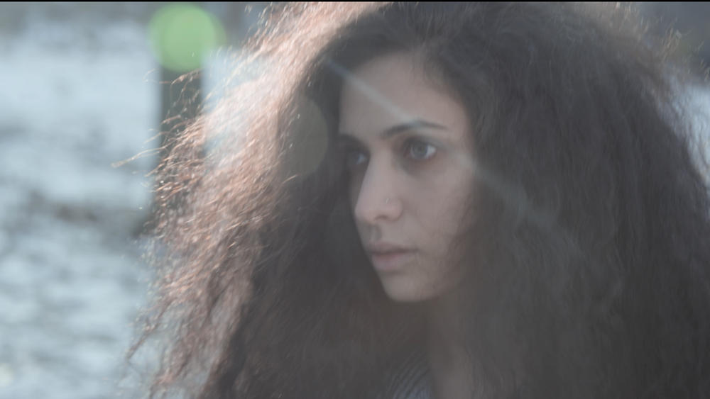 Still from I Say Dust starring Hala Alyan