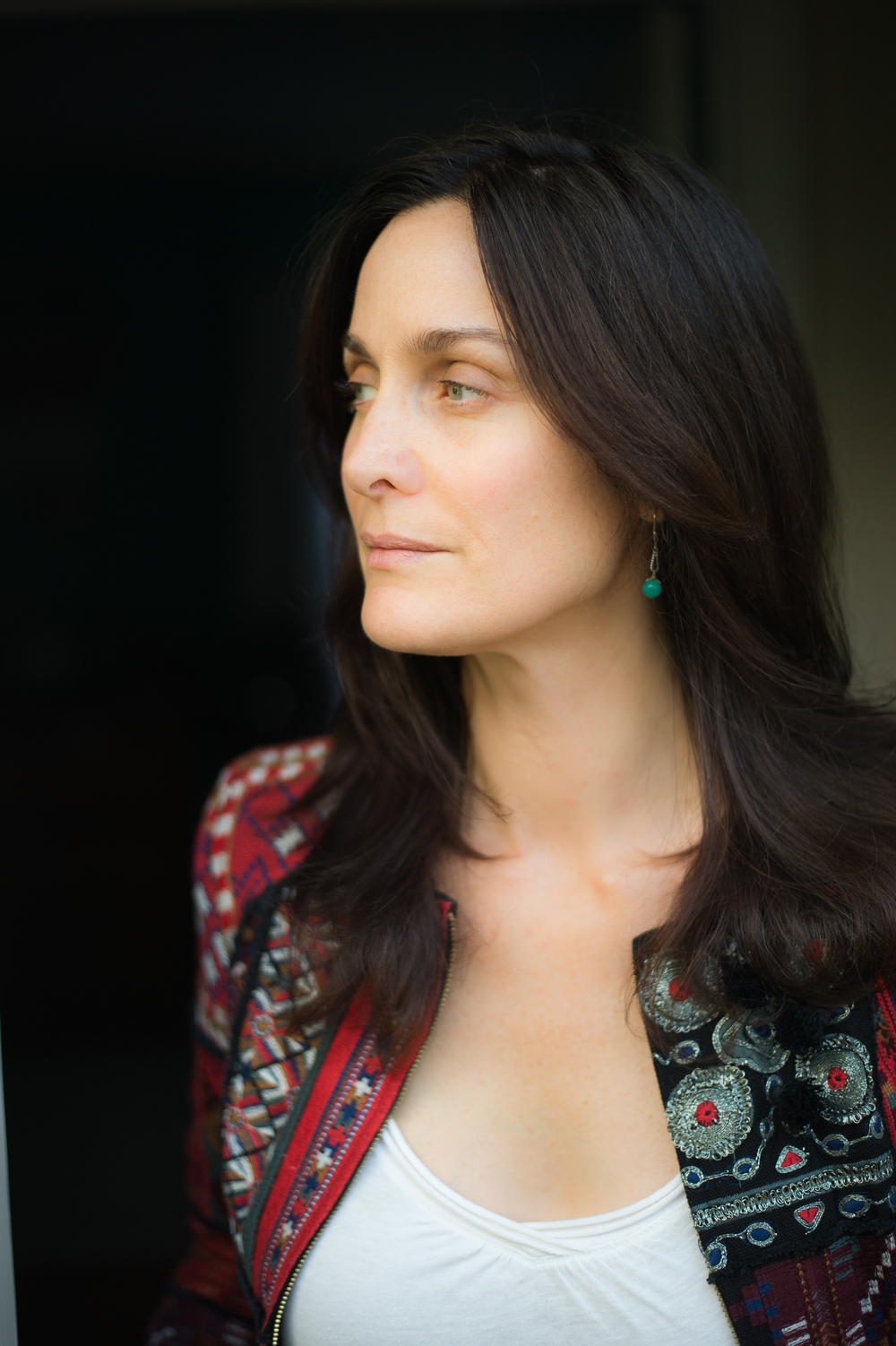 Carrie Anne Moss via AnnapurnaLiving.com