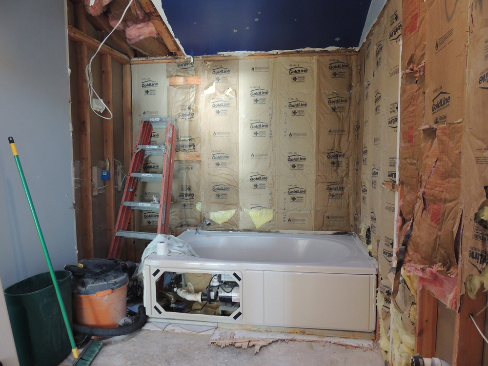 This stage of gutting the bathroom on October 5, 2014, will soon rid us of the problematic pink tub.
