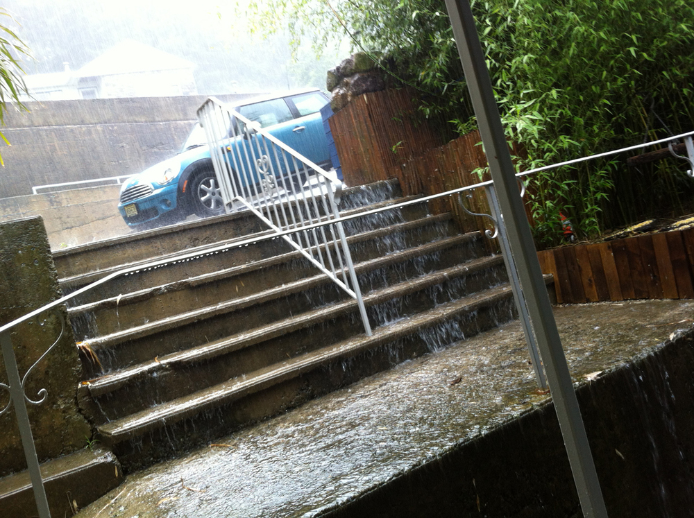 The stairs down to our home also serve as a water feature during storms.
