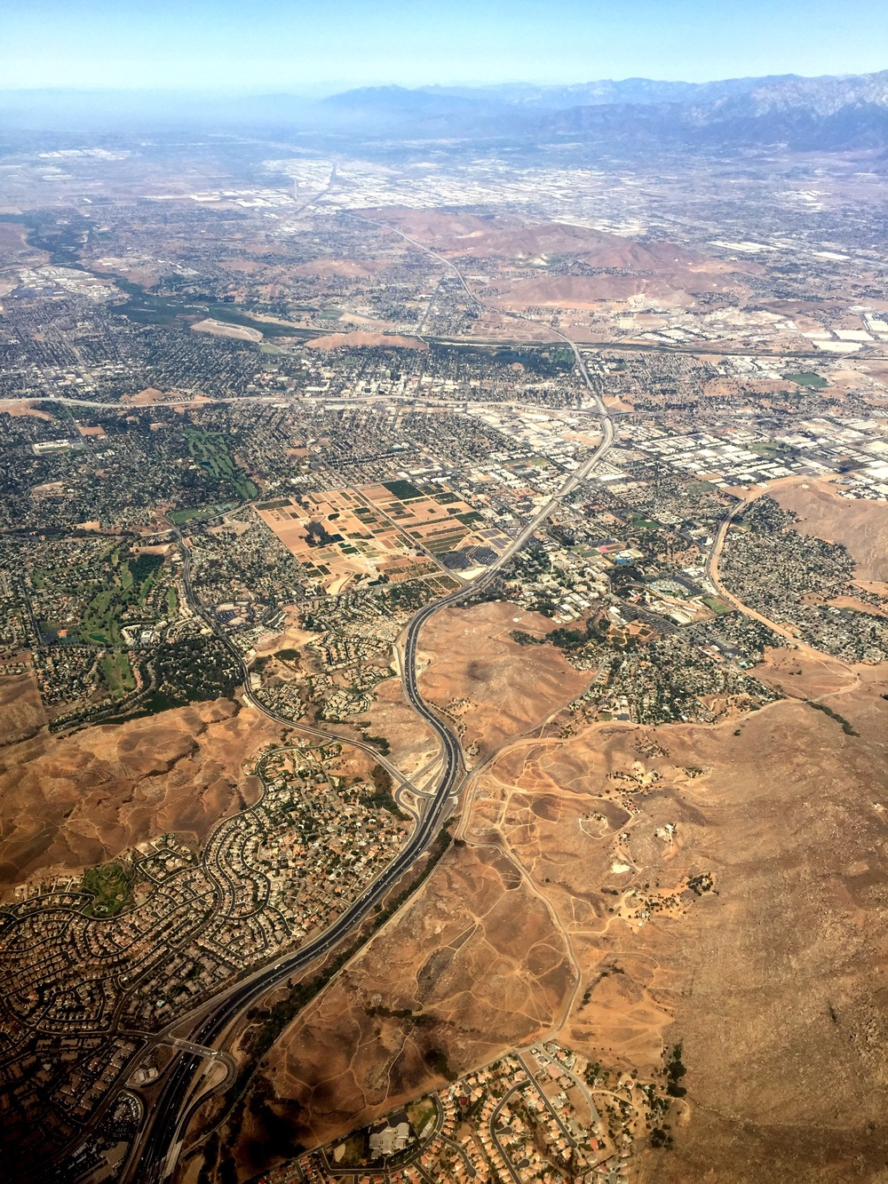 Over Moreno County - Box Springs as we begin the approach for a slightly early landing at John Wayne Airport in Orange County, where the local time is 10:56 AM.