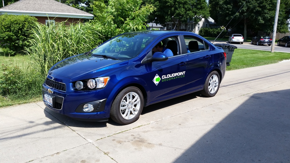 Cloudpoint's new Chevy Sonic with almost the whole crew loaded inside.