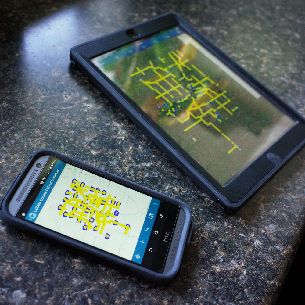 Esri's Collector application works on a variety of platforms.  Here you can see the application pulled up on an HTC smartphone and an iPad tablet which have different operating systems.