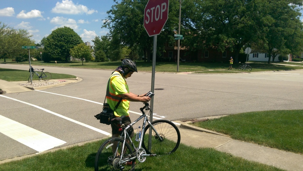 Here you can see Joe using his bicycle mounted iPad to inventory one of the thousands of signs within Bloomington's jurisdiction.  The bike mounts are a great addition for this type of inventory work.